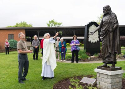 Fr. Jim Dugal, C.PP.S., blesses a new statute of Jesus at the Maria Stein Shrine of the Holy Relics. Photo credit: Anthony Dugal.