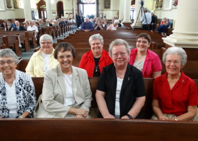 Sisters of the Precious Blood, front row, and Sister Adorers of the Blood of Christ (ASC), back row, before Mass.