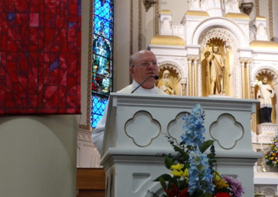 Fr. Gene Schnipke, C.PP.S., pastor of St. John the Baptist, welcomes all to the ordination Mass.