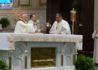 Bishop Joseph Charron, C.PP.S., presider, incenses the altar at the opening of Mass.