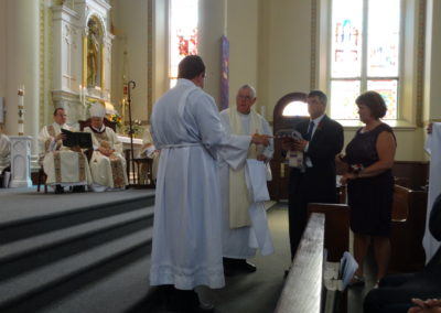 Matt's vestments are presented to him by his family and Fr. Ken Schroeder.