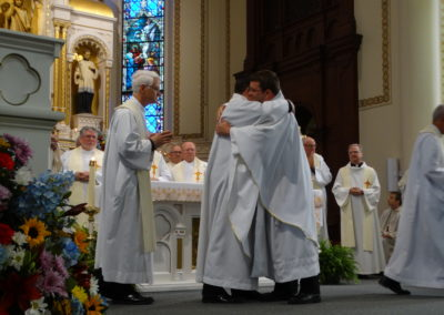 Fr. Jim Smith, C.PP.S., embraces Fr. Matt.