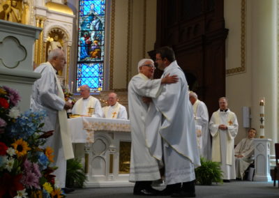 Fr. Tom Brenberger, C.PP.S., embraces Fr. Matt.