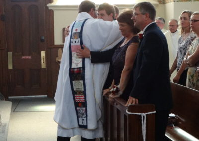 Fr. Matt embraces his family during the sign of peace.