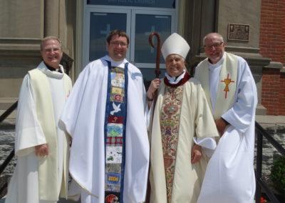 Fr. Larry J Hemmelgarn, Fr. Matthew Keller, Bishop Joseph Charron, Fr. Bill Nordenbrock.