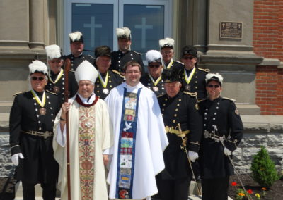 Bishop Charron and Fr. Matthew Keller with the Knights of St. John.