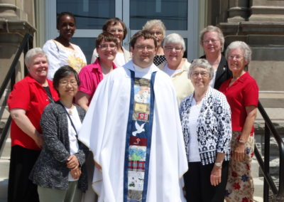 Fr. Matthew Keller with Sisters of the Precious Blood and Adorers of the Blood of Christ. — with Maria Hughes, Carolyn Hoying and Martha Bertke.