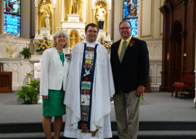 Fr. Matthew Keller with his godparents, Janet Rindler and James Ahrns.
