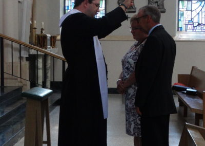 Fr. Matthew Keller offers first blessings in Assumption Chapel at St. Charles.