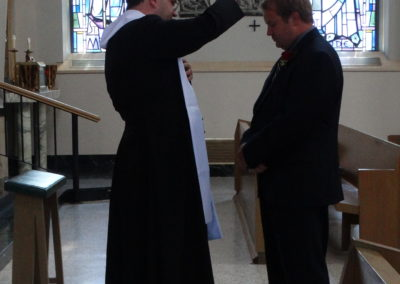 Fr. Matthew Keller blesses his brother, Scott.
