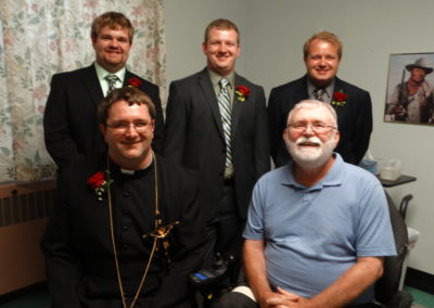 Br. Paul Chase with Fr. Matthew Keller and his brothers. Br. Paul first hired Matt to work at St. Charles when Matt was 17. His brothers have worked there too.