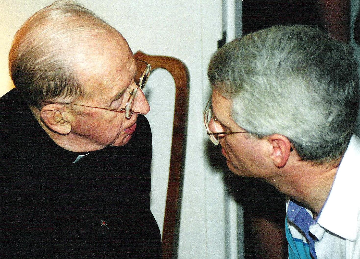 Fr. Angelo, C.PP.S., listening to Fr. Harold Diller, C.PP.S.